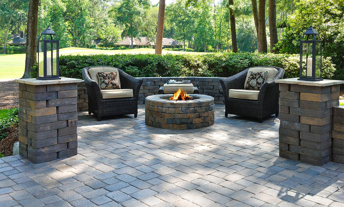 patio with a fire pit all in grey colors
